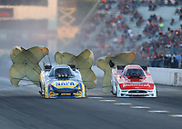 Sep 22, 2018; Madison, IL, USA; NHRA funny car driver Ron Capps (left) alongside Bob Tasca III during qualifying for the Midwest Nationals at Gateway Motorsports Park. Mandatory Credit: Mark J. Rebilas-USA TODAY Sports