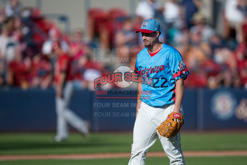 Spokane Indians starting pitcher Chi Chi Gonzalez (22) walks off the field in a rehab assignment during a Northwest League game against the Vancouver Canadians at Avista Stadium on September 2, 2018 in Spokane, Washington. The Spokane Indians defeated the Vancouver Canadians by a score of 3-1. (Zachary Lucy/Four Seam Images)