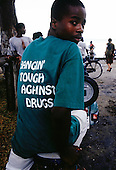 Zanzibar, Tanzania. Youth with 'hangin' tough against drugs' t-shirt.