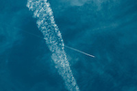 Jet aircraft contrails (condensation trails).