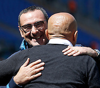 Calcio, Serie A: Roma vs Napoli. Roma, stadio Olimpico, 25 aprile 2016.<br /> Roma's coach Luciano Spalletti, back to camera, greets Napoli's coach Maurizio Sarri prior to the start of the Italian Serie A football match between Roma and Napoli at Rome's Olympic stadium, 25 April 2016. <br /> UPDATE IMAGES PRESS/Isabella Bonotto