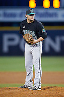 Coastal Carolina Chanticleers relief pitcher Seth Lamando (12) looks to his catcher for the sign against the High Point Panthers at Willard Stadium on March 15, 2014 in High Point, North Carolina.  The Panthers defeated the Chanticleers 11-8 in game two of a double-header.  (Brian Westerholt/Four Seam Images)