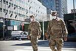 Members of the U.S. army walk past the Office of Chief Medical Examiner's temporary morgue during the coronavirus pandemic on April 6, 2020 in New York City.  More than 10,000 people have died from COVID-19 in the U.S..  Photograph by Michael Nagle