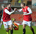 Dundee Utd's David Goodwillie (right) celebrates with Nadir Ciftci after he scores their first goal.