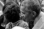 Isaiah Mandela Johnson receives a hug from  former President Barack Obama at a political rally in support of the re-election of Governor Tom Wolf and Senator Bob Casey, at the Dell.