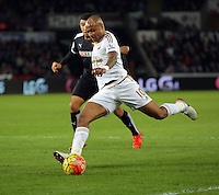 Andre Ayew of Swansea crosses the ball during the Barclays Premier League match between Swansea City and Watford at the Liberty Stadium, Swansea on January 18 2016
