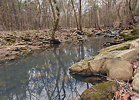A creek flows past the farmstread toward the Buffalo River a short distance away.<br />