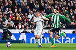 Lucas Vazquez of Real Madrid competes for the ball with of Real Betis  during the match of Spanish La Liga between Real Madrid and Real Betis at  Santiago Bernabeu Stadium in Madrid, Spain. March 12, 2017. (ALTERPHOTOS / Rodrigo Jimenez)