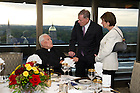September 29, 2011; Rev. Theodore M. Hesburgh, C.S.C., chats with Dr. Horst Koehler, former President of the Federal Republic of Germany, and wife, Eva Luise Koehler before dinner in the 14th floor penthouse of the Hesburgh Library. Photo by Barbara Johnston/University of Notre Dame