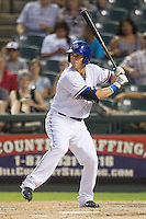 Round Rock Express first baseman Chris McGuiness (21) at bat against the Oklahoma City RedHawks during the Pacific Coast League baseball game on August 25, 2013 at the Dell Diamond in Round Rock, Texas. Round Rock defeated Oklahoma City 9-2. (Andrew Woolley/Four Seam Images)