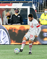 FOXBOROUGH, MA - OCTOBER 7: Alejandro Pozuelo #10 of Toronto FC passes the ball during a game between Toronto FC and New England Revolution at Gillette Stadium on October 7, 2020 in Foxborough, Massachusetts.