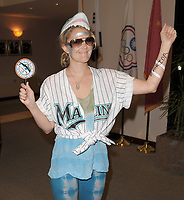 MIAMI, FL - JUNE 19:  (EXCLUSIVE COVERAGE)  Actors Justin Long and Drew Barrymore attend The Florida Marlins VS. New York Yankees. At Land Shark Stadium in Miami. The couple laughed and joked and looked very much in love as they enjoyed the game and some beer with friends Drew came dressed up in full Marlins attire along with a shark hat and tattoo's to show her support for the winning Marlins.  She also was sporting a tongue ring and peircing<br /> <br /> This was the third-largest home crowd in history, and their biggest of the season, witnessed a spectacular pitchers' duel between Johnson and A. J.  Burnett. The 46,427 on hand was the largest non-Opening Day draw in franchise history. on June 20, 2009 in Miami, Florida<br /> <br /> People:  Drew Barrymore, Justin Long