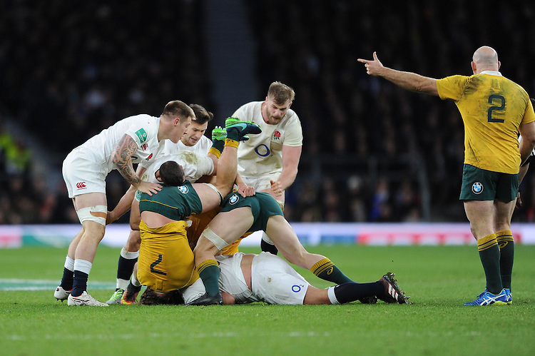 Michael Hooper of Australia comes off second best as England dominate play during the Old Mutual Wealth Series match between England and Australia at Twickenham Stadium on Saturday 3rd December 2016 (Photo by Rob Munro)