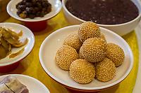 Yangzhou, Jiangsu, China.  Breakfast at Ye Chun Tea House.  Sesame Seed Glutinous Rice Balls.