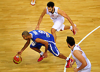 French national basketball team players Tony Parker and Calderon Jose, during final Eurobasket 2011 game between Spain and France in Kaunas, Lithuania, Sunday, September 18, 2011. (photo: Pedja Milosavljevic)