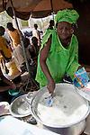 A woman sells bowls of tapioca in milk near the Grand Marche of Bamako, Mali.