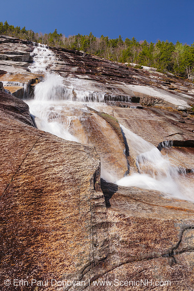 A seasonal waterfall on the side of Mount Willey in Crawford Notch of Hart's Location, New Hampshire during the spring season. During the winter season this ledge is a popular ice climbing spot.
