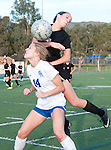 JSerra's Linda Edwards goes over the top of Santa Margarita's Machaela George to head the ball in Tuesday's league action.