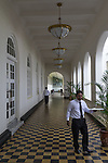 18 August 2015,Colombo, Sri Lanka:  Wait staff walk the tiled hallway to the bistro area at the historic Galle Face Hotel,  Colombo, Sri Lanka.     Picture by Graham Crouch