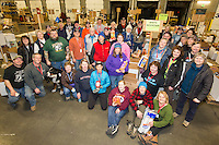 Volunteers take a break from sorting and packing human food to take a group photo at the Airland Transport warehouse in Anchorage on Friday, February 19, 2016 prior to the Iditarod 2016 race.