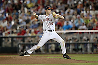 Artie Lewicki #34 of the Virginia Cavaliers pitches during Game 4 of the 2014 Men's College World Series between the Virginia Cavaliers and Ole Miss Rebels at TD Ameritrade Park on June 15, 2014 in Omaha, Nebraska. (Brace Hemmelgarn/Four Seam Images)