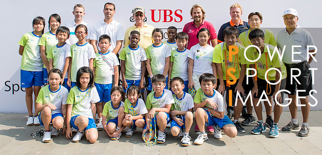 Players attend a clinic with kids ahead the UBS Hong Kong Open golf tournament at the Fanling golf course on 21 October 2015 in Hong Kong, China. Photo by Moses Ng / Power Sport Images