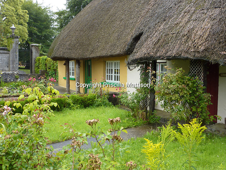 Adare, Republic of Ireland - July 18, 2010:  Two thatch-roofed cottages nestle together.