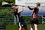 GER - Hannover, Germany, May 30: During the Women Lacrosse Playoffs 2015 match between DHC Hannover (black) and SC Frankfurt 1880 (red) on May 30, 2015 at Deutscher Hockey-Club Hannover e.V. in Hannover, Germany. Final score 23:3. (Photo by Dirk Markgraf / www.265-images.com) *** Local caption *** Anna Blank #16 of DHC Hannover, Hanna Kolass #16 of SC 1880 Frankfurt
