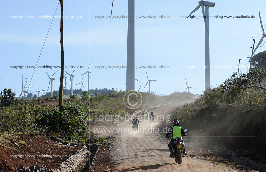 KENYA, Nairobi, Ngong Hills, 25,5 MW Wind Power Station with Vestas and Gamesa wind turbines, owned and operated by KENGEN Kenya Electricity Generating Company, youngster with motorbike / KENIA, Ngong Hills Windpark, Betreiber KenGen Kenya Electricity Generating Company mit Vestas und Gamesa Windkraftanlagen, Jugendliche mit Motorraedern