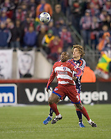 Substitute FC Dallas forward Jeff Cunningham (9) and New England Revolution defender Chris Albright (3) battle for head ball. The New England Revolution defeated FC Dallas, 2-1, at Gillette Stadium on April 4, 2009. Photo by Andrew Katsampes /isiphotos.com