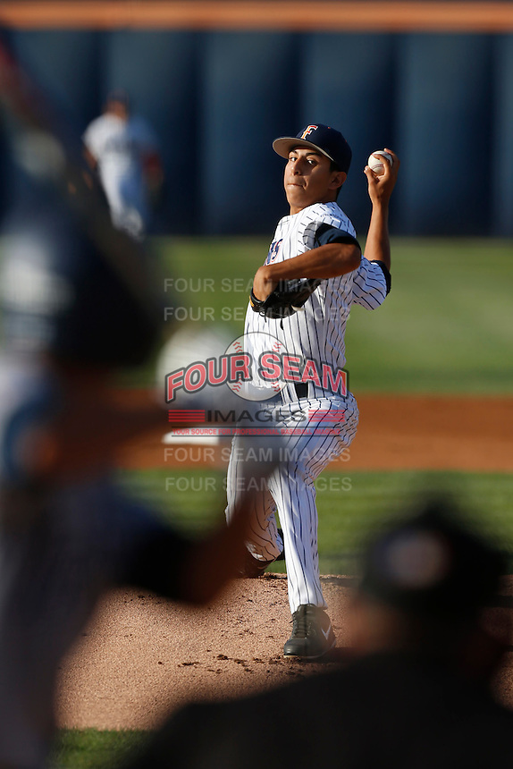 Justin Garza #8 of the Cal State Fullerton Titans pitches against the UC Irvine Anteaters at Goodwin Field on May 18, 2013 in Fullerton, California. Fullerton defeated UC Irvine, 3-2. (Larry Goren/Four Seam Images)