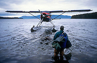Fishing Guide waits to be picked up by a float plane in Hawk Inlet in southeast Alaska. M