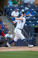 Jake Cronenworth (1) of the Durham Bulls follows through on his swing against the Columbus Clippers at Durham Bulls Athletic Park on June 1, 2019 in Durham, North Carolina. The Bulls defeated the Clippers 11-5 in game one of a doubleheader. (Brian Westerholt/Four Seam Images)