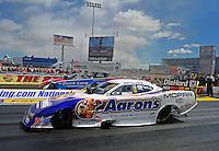 Apr. 1, 2012; Las Vegas, NV, USA: NHRA funny car driver Matt Hagan (near lane) races alongside Bob Tasca III during the Summitracing.com Nationals at The Strip in Las Vegas. Mandatory Credit: Mark J. Rebilas-
