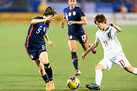 FRISCO, TX - MARCH 11: Kelley O'Hara #5 of the United States watches the ball in front of Riko Ueki #11 of Japan during a game between Japan and USWNT at Toyota Stadium on March 11, 2020 in Frisco, Texas.