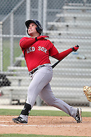 Boston Red Sox outfielder Juan Carlos Linares #38 hits a home run during an Instructional League game against the Minnesota Twins at Red Sox Minor League Training Complex in Fort Myers, Florida;  October 3, 2011.  (Mike Janes/Four Seam Images)