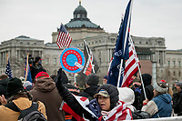 People pray to the sound of a Bile passage over a bullhorn, as a small crowd of President Trump supporters gather on the west side of the U.S. Capitol in the hours before the Electoral votes are to be counted during a joint session of the United States Congress to certify the results of the 2020 presidential election in the US House of Representatives Chamber in the US Capitol in Washington, DC on Wednesday, January 6, 2021. Congressional Republicans have announced they are going to challenge the Electoral votes from up to six swing states.<br /> CAP/MPI/RS<br /> ©RS/MPI/Capital Pictures