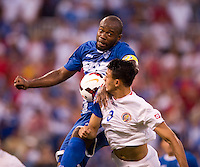 Osman Chavez (2) of Honduras fights for the ball with Giancarlo Gonzalez (3) of Costa Rica during the quarterfinals of the CONCACAF Gold Cup at M&T Bank Stadium in Baltimore, MD.  Honduras defeated Costa Rica, 1-0.