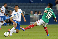 Wilmer Fuentes (8) Honduras passes the ball before Marco Fabian (10) Mexico can intercept... Mexico defeated Honduras 2-1 after extra time to win the CONCACAF Olympic qualifying trophy at LIVESTRONG Sporting Park, Kansas City, Kansas.
