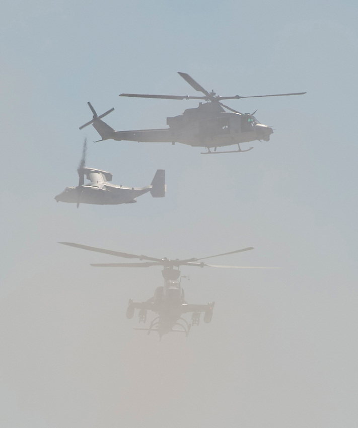 """121014-N-DR144-346 SAN DIEGO (October 14, 2012)- From top, a UH-1Y Huey, an MV-22 Osprey, and an AH-1Z Super Cobra take part in an air-ground assault demonstration during the Marine Corps Air Station Miramar 2012 Air Show. The air show, held October 12-14, was themed """"Marines In Flight: Celebrating 50 Years of Space Exploration."""" (U.S. Navy photo by Mass Communication Specialist 1st Class James R. Evans / RELEASED)"""