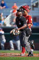 Umpire Dexter Kelley gets keeps his eye on a popup in as catcher catcher Luis Vilorio (4) looks on during a game between the Mahoning Valley Scrappers and Auburn Doubledays on June 19, 2016 at Falcon Park in Auburn, New York.  Mahoning Valley defeated Auburn .  (Mike Janes/Four Seam Images)