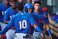 AZL Rangers Keyber Rodriguez (22) and Alexander Ovalles (10) bump chests after Rodriguez's second-inning home run during an Arizona League game against the AZL Athletics Gold on July 15, 2019 at Hohokam Stadium in Mesa, Arizona. The AZL Athletics Gold defeated the AZL Rangers 9-8 in 11 innings. (Zachary Lucy/Four Seam Images)