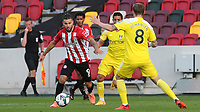 Emiliano Marcondes of Brentford takes on Fulham's Stefan Johansen during Brentford vs Fulham, Caraboa Cup Football at the Brentford Community Stadium on 1st October 2020