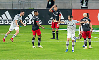 WASHINGTON, DC - NOVEMBER 8: Rudy Camacho #4 and Jorge Corrales #26 of the Montreal Impact celebrates as Yamil Asad #11 of D.C. United holds his head during a game between Montreal Impact and D.C. United at Audi Field on November 8, 2020 in Washington, DC.