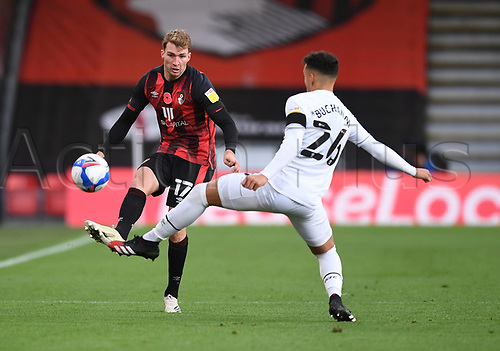 31st October 2020; Vitality Stadium, Bournemouth, Dorset, England; English Football League Championship Football, Bournemouth Athletic versus Derby County; Jack Stacey of Bournemouth plays the ball forward under pressure from Lee Buchanan of Derby County