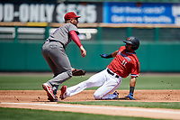 Rochester Red Wings left fielder LaMonte Wade (11) slides into third base in front of Mitch Walding (10) during a game against the Lehigh Valley IronPigs on July 1, 2018 at Frontier Field in Rochester, New York.  Rochester defeated Lehigh Valley 7-6.  (Mike Janes/Four Seam Images)