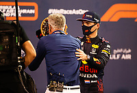 27th March 2021; Sakhir, Bahrain; F1 Grand Prix of Bahrain, Qualifying sessions;  VERSTAPPEN Max (ned), Red Bull Racing Honda RB16B who took pole position puts a birhday cake in the face of interviewer David Coulthard during Formula 1 Gulf Air Bahrain Grand Prix 2021 qualifying