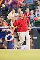 """Richmond Flying Squirrels Vice President/COO Todd """"Parney"""" Parnell competes in the """"Hillbilly Horseshoes"""" contest between innings of the Eastern League game against the New Hampshire Fisher Cats at The Diamond on June 13, 2014 in Richmond, Virginia.  (Brian Westerholt/Four Seam Images)"""