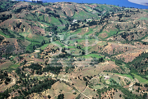 Chile. Hilly rural farmland south of Santiago with farms.