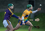 Gary Cooney of Clare in action against Shaun Murphy of Wexford during the Jack Lynch Memorial game at Tulla. Photograph by John Kelly.